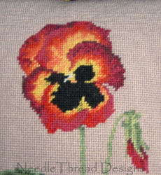 Needlepoint: tapestry pansy in tent stitch on canvas