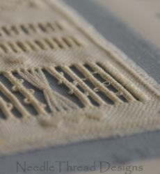 Whitework: close up of cutwork techniques on linen