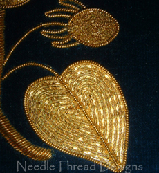 Goldwork: close up of a leaf using metal threads, padding and applique - beginner's level
