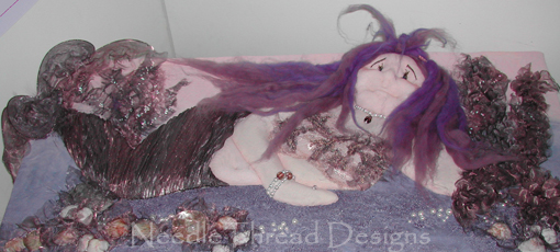 Stumpwork: raised embroidery mermaid using padding, applique, hand and machine embroidery