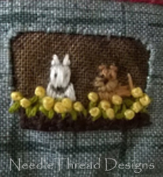 Embroidered appliqué: 2 dogs embroidered in a tiny window