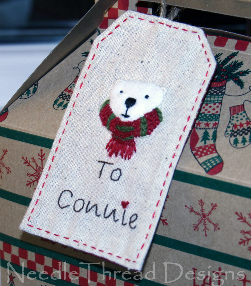 embroidered Christmas gift tag with a stumpwork (raised or padded) polar bear