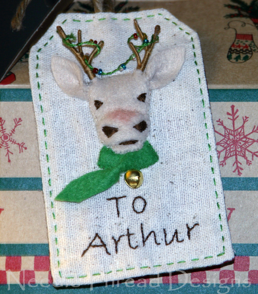 embroidered Christmas gift tag with a stumpwork (raised or padded) reindeer