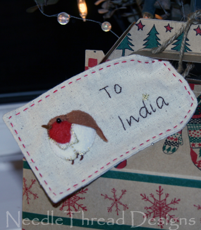embroidered Christmas gift tag with a stumpwork (raised or padded) robin